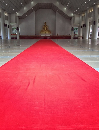 wish: Red carpet in front of Buddha