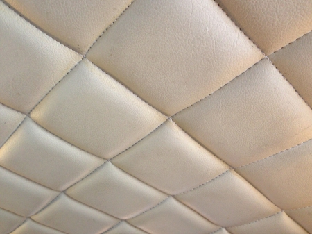 matrass: Upholstery  grey leather pattern with knobs