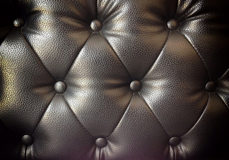 button tufted: black leather fabric from the sofa