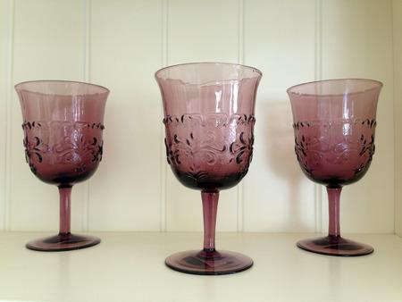 concoct: Three purple glasses on white background