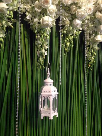 White roses with lantern Stock Photo