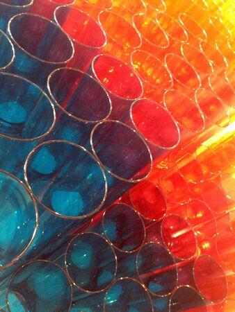 Plastic glass in colourful Stockfoto