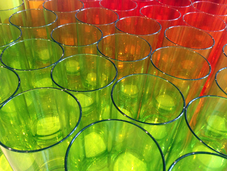 Plastic glass in colourful photo