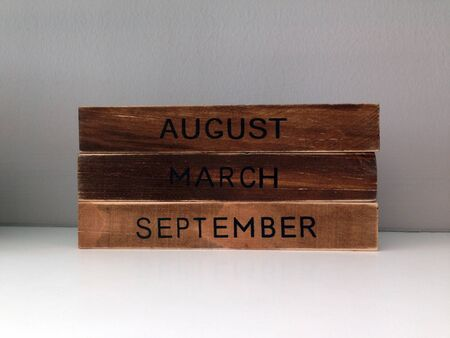 Months screen on wooden cubic of august, march, september