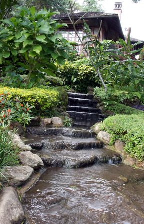 Beautiful decorative home garden stone waterfall pond photo