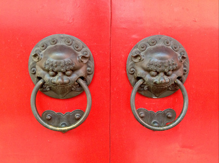 Chinese brass dragon knocker on wooden doors photo