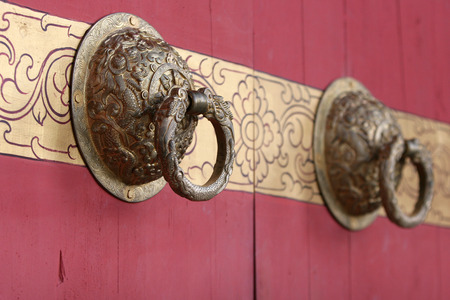Brass knocker on wooden doors photo