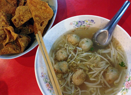 meatballs shrimp noodle soup with Deep Fried Wonton photo