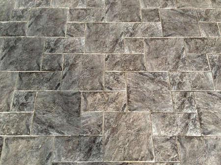 Gray tiled floor background photo
