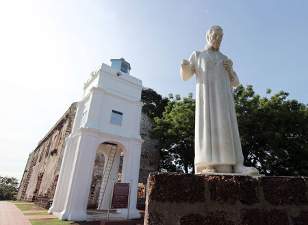 st  francis: Exterior view of St. Pauls Church in Malacca, Malaysia with a statue of St. Francis Xavier in front