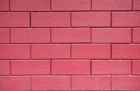 brick and mortar: Dark red common brick wall background textured