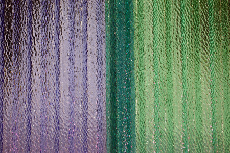 corrugated and translucent glass of window - Purple and green colored photo