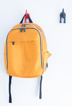 Orange backpack on the wall