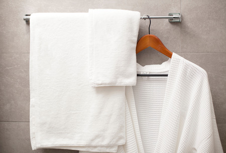 terry: towel and robe on the rack in the bathroom