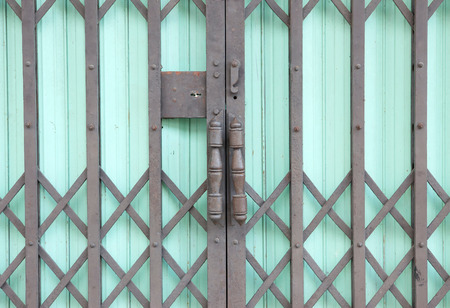 close up of green steel door can be used for interior design photo