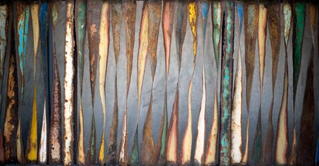 abstract colorful wallpaper grunge background of the old iron rusty artistic wall peeling paint. photo