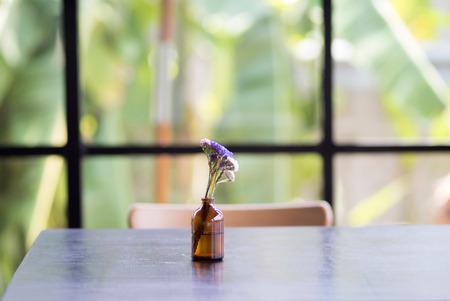 flower on wood table near window Stock Photo