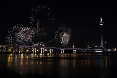 International firework shows light up the sky with dazzling display near Bridge Ponte de Sai Van and Macau tower