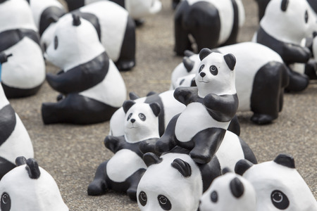 lumpini: CHIANG MAI,THAILAND March 19, 2016 : Pandas World Tour by WWF exhibition of the 1,600 paper mache pandas during a flash mob  world tour made by French artist Paulo Grangeon at Tha Phae Gate, Chiang Mai.