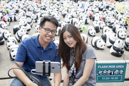 mob: CHIANG MAI,THAILAND March 19, 2016 : Pandas World Tour by WWF exhibition of the 1,600 paper mache pandas during a flash mob  world tour made by French artist Paulo Grangeon at Tha Phae Gate, Chiang Mai.