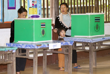 polling station: CHIANG MAI, THAILAND - AUGUST 07 : Hmong hill tribe people to cast their ballots in the referendum on a new constitution at a polling station on a mountain, in Chiang Mai,Thailand,07 August 2016. Editorial