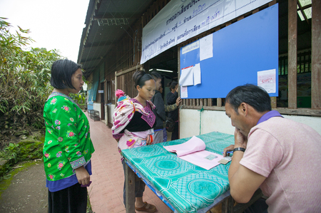 polling station: CHIANG MAI, THAILAND - AUGUST 07 : Hmong hill tribe people to cast their ballots in the referendum on a new constitution at a polling station on a mountain, the first polling in the country after the May 2014 military coup, in Chiang Mai,Thailand,07 Augus
