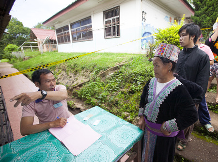 military draft: CHIANG MAI, THAILAND - AUGUST 07 : Hmong hill tribe people to cast their ballots in the referendum on a new constitution at a polling station on a mountain, the first polling in the country after the May 2014 military coup, in Chiang Mai,Thailand,07 Augus