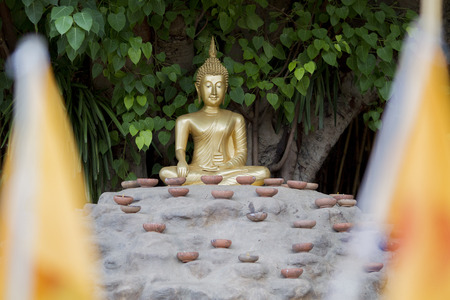 the Buddha with candles and in Phan Tao Temple, Chiangmai, Thailand