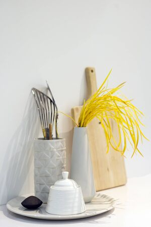 Chopping Wood, bowls and other utensils in metal containers on table