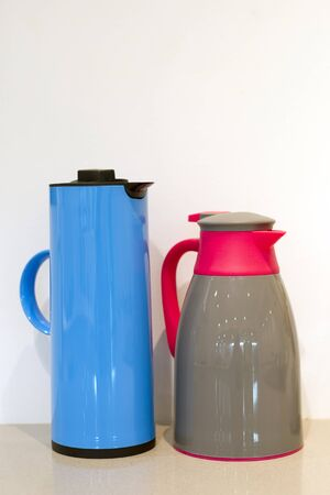 blue with blacl and brown with red jug on the table Stock Photo