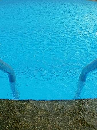 bl: Raining at swimming pool. Stock Photo