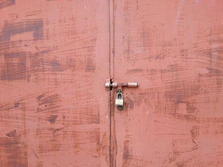 puerta de metal: Puerta del metal y la clave de fondo de textura de bloqueo