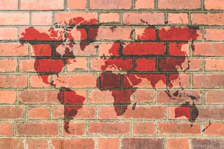Red Brick wall texture background with world map photo