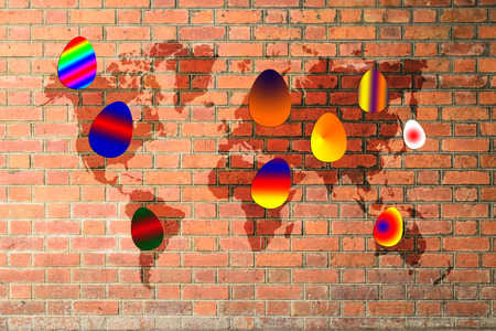 Colorful easter eggs on red brick wall texture background with world map photo