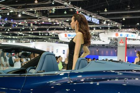 jolie fille: Nonthaburi, Tha�lande - le 29 Mars, 2015: Jolie fille dans le Salon de l'automobile international de Bangkok 36e 2015 � la salle Challenger, IMPACT Muang Thong Thani. Editeur