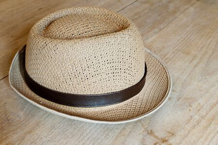 wood table: Weave hat on wood table