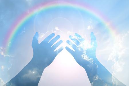 Hand on Blue sky and sunlight with rainbow