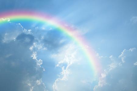 Blue sky and white cloud with sun light and rainbow Standard-Bild
