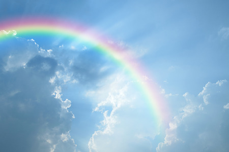 clear day: Blue sky and white cloud with sun light and rainbow Stock Photo