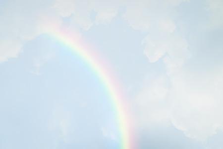 青い空と白い雲が太陽の光と虹 写真素材