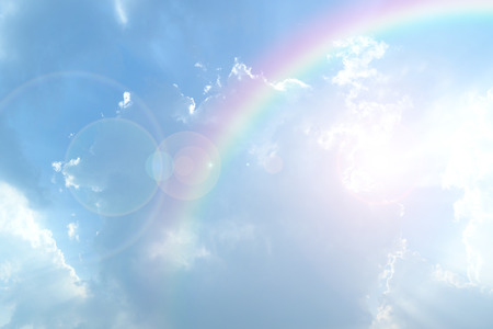 rainbow background: Blue sky and white cloud with sun light and rainbow Stock Photo