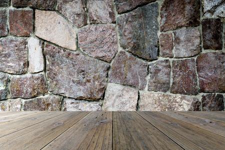Houten terras en stenen muur interieur textuur achtergrond Stockfoto