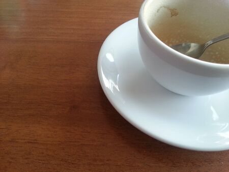 repast: Empty coffee in white cup on wood table