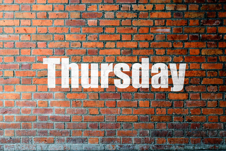 thursday: Red Brick wall texture background with a word Thursday Stock Photo