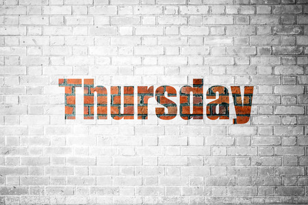Red Brick wall texture background with a word Thursday Banco de Imagens