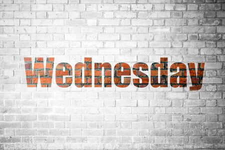 wednesday: Red Brick wall texture background with a word Wednesday