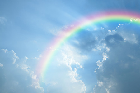 rainbow scene: Blue sky and white cloud with sun light and rainbow Stock Photo