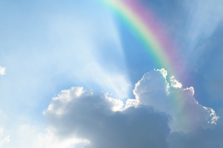 rainbow scene: Nature cloudscape with blue sky and white cloud with rainbow