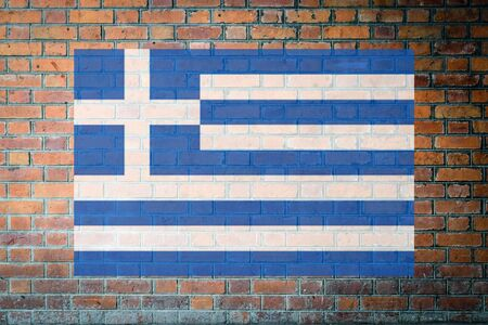 Red Brick wall texture background with Greece flag. Stock Photo