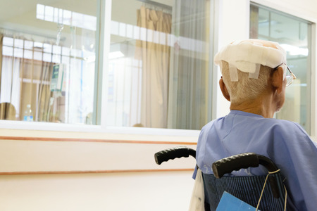 Patient elderly man with head injury on wheelchair in hospital